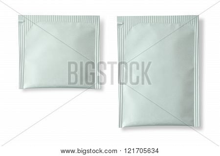Blank white plastic sachet for medicine drugs coffee sugar salt spices isolated on white background .