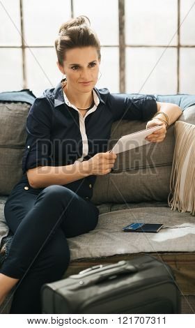 Woman Ordering Ticket Online With Tablet Pc In Loft Apartment