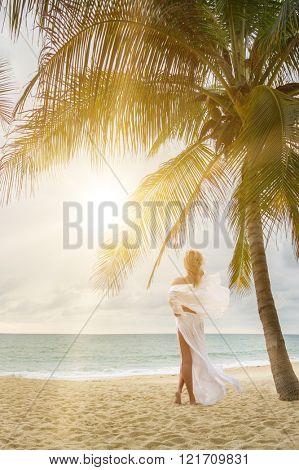 woman with beautiful sarong on tropical beach