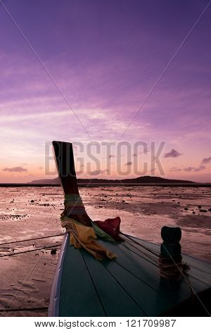 Long tail fishing boats at sunet in Thailand