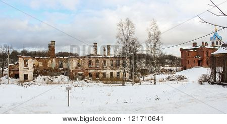 Staraya Ladoga, Russia - 23 February, Destroyed building and the church of the monastery, 23 February 2016. Tourist places in the great ancient route from the Vikings to the Greeks.Staroladozhsky Holy Assumption nunnery. Gold ring of Russia.