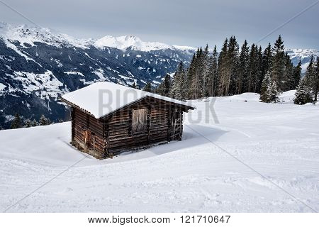 A wooden barn on the snowy slopes of the Karspitz Mountain, Zillertal, Austria
