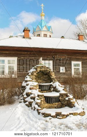 Staraya Ladoga, Russia - 23 February, Stone fountain in winter, 23 February 2016. Tourist places in the great ancient route from the Vikings to the Greeks.Staroladozhsky Holy Assumption nunnery. Gold ring of Russia.