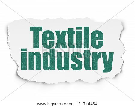 Manufacuring concept: Textile Industry on Torn Paper background