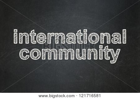 Politics concept: International Community on chalkboard background