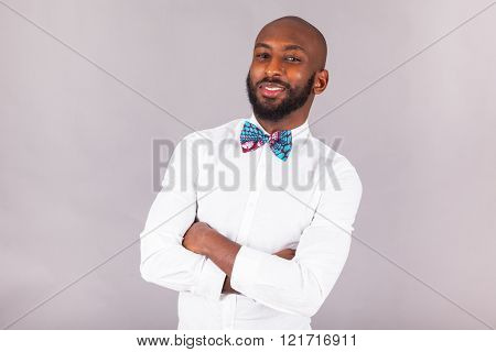 African American Young Man With Folded Arms Wearing A Bow Tie