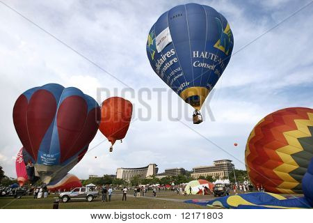 PUTRAJAYA, MALAYSIA - March 19: Colorful hot air balloons at the First Putrajaya International Hot Air Balloon Fiesta 2009. The event was held March 19, 2009 in Precinct 2, Putrajaya, Malaysia.