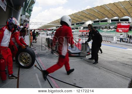SEPANG, MALAYSIA - AUGUST 8: Honda Team mechanics ready for pit lane action at the 12 hour race of the 2009 Merdeka Millennium Endurance Race August 8, 2009 in Sepang, Malaysia.