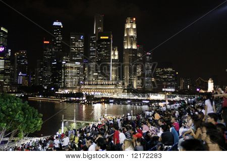 SINGAPORE - SEPTEMBER 26: Night view of spectators and city skyline at the 2008 Singtel Singapore F1 Grand Prix on September 26, 2008 in Marina Bay Circuit, Singapore.