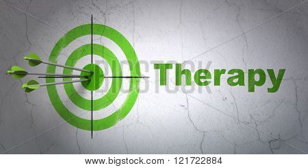 Healthcare concept: target and Therapy on wall background