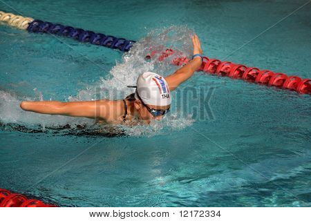 KUALA LUMPUR - AUGUST 14: Thailand's handicapped amputee swimmer swims at the fifth ASEAN Para Games on August 14, 2009 in Kuala Lumpur, Malaysia.