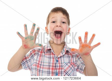 shouting boy with colorful painted fingers spread