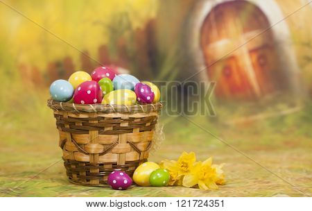 Colorful Easter eggs and Yellow daffodil flowers and colorful Easter eggs in basket