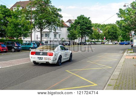 STRASBOURG FRANCE - JUN 27 2015: Ford Mustang car with racing stickers and sponsorship advertising making noise in calm neighborhood