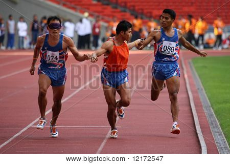 KUALA LUMPUR - AUGUST 18: Thailand's visually impaired relay team in action at the track and field event of the fifth ASEAN Para Games on August 18, 2009 in Kuala Lumpur, Malaysia.