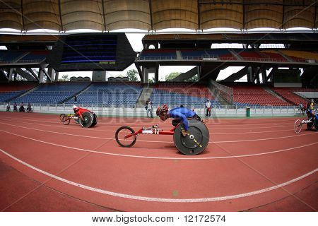 KUALA LUMPUR - AUGUST 16: ASEAN nations' wheel chair athletes compete at the track and field event of the fifth ASEAN Para Games on August 16, 2009 in Kuala Lumpur, Malaysia.