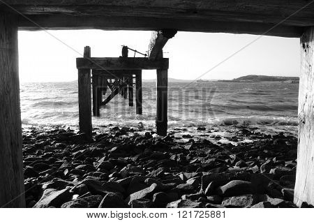 A view under the old wooden pier at Aberdour