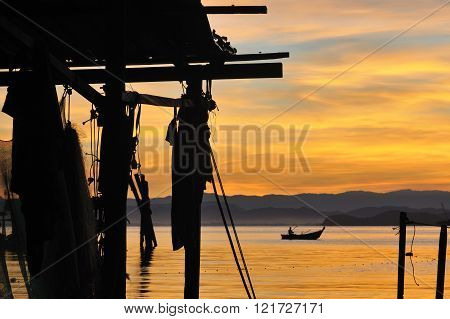 Life of a fisherman in silhouette during sunrise