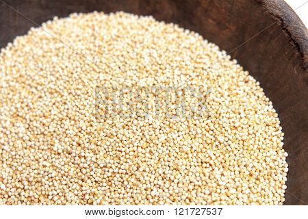 Amaranth Puffed In Rustic Wooden Bowl Isolated White Background