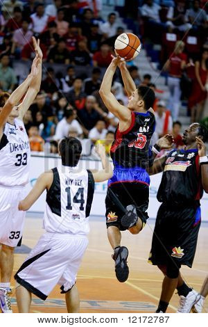 KUALA LUMPUR - NOVEMBER 15: Philippine Patriots' Dino Daa shooting against KL Dragons in the ASEAN Basketball League match. November 15, 2009 in Kuala Lumpur.