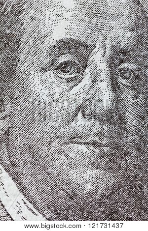 Benjamin Franklin on one hundred dollar bill. Macro background