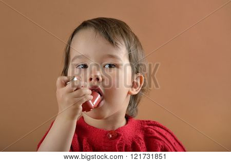 Little girl breathing asthmatic medicine health-care inhaler
