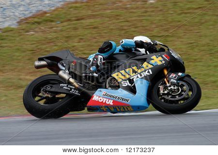 SEPANG - FEBRUARY 05: Alvaro Bautista of the Rizla-Suzuki team practices in the pre-season testing in preparation for the MotoGP championship. February 05, 2010 in Sepang, Malaysia.