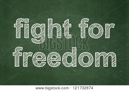 Political concept: Fight For Freedom on chalkboard background