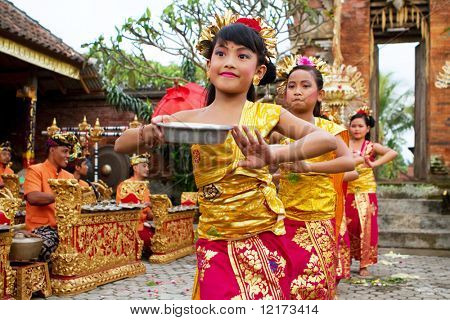 BALI - JANUARY 15: Young dancers perform a welcome dance in a 'full moon ceremony' in the Bedulu village in Ubud, Bali. January 15, 2010 in Bali, Indonesia.