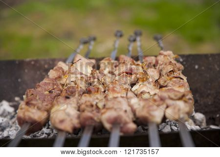Bar-B-Q or BBQ with kebab cooking.