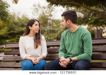 Young couple talking at a park