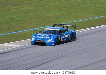 SEPANG, MALAYSIA - JUNE 21: The Calsonic Impul GT-R Nissan car (12) in action at the Super GT International Series Round 4 race. June 21, 2010 in Sepang Malaysia.