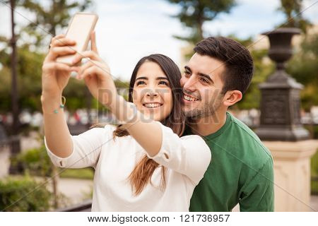 Cute couple taking a selfie outdoors