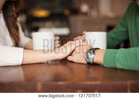 Holding hands at a coffee shop
