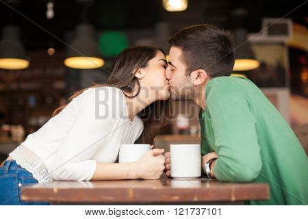 Young couple kissing in a restaurant