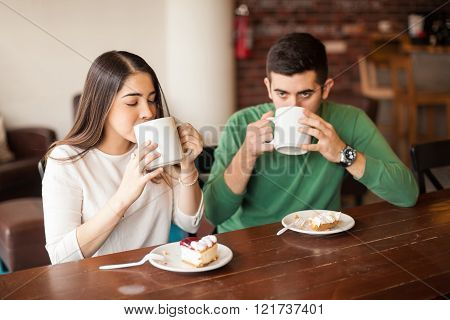 Young Couple Enjoying A Cup Of Coffee