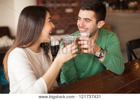 Couple Giving A Toast With Beer