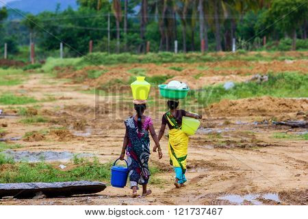 Indian village women on the way back from collecting drinking water in the monsoon period. ** Note: Soft Focus at 100%, best at smaller sizes