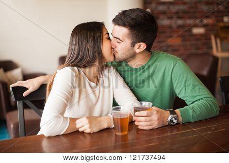 Young couple kissing at a bar