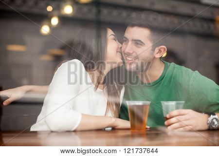Beautiful Girl Flirting With A Guy At The Bar