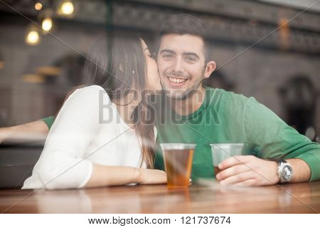 Young Man Drinking Beer With His Girlfriend