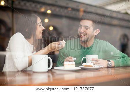Boyfriend And Girlfriend In A Coffee Shop