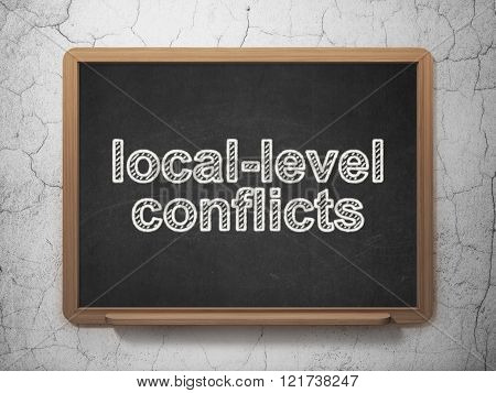 Political concept: Local-level Conflicts on chalkboard background