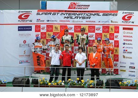 SEPANG, MALAYSIA - JUNE 21: The GT300 winners podium after the prize presentation at the Super GT International Series Round 4 race. June 21, 2010 in Sepang Malaysia.