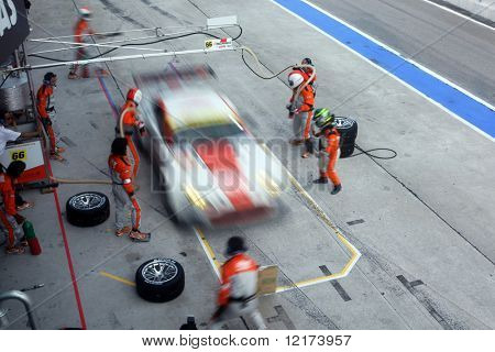 SEPANG, MALAYSIA - JUNE 21: The Triple a Vantage GT2 car (66) coming in for pit-stop during the Super GT International Series Round 4 race. June 21, 2010 in Sepang Malaysia.