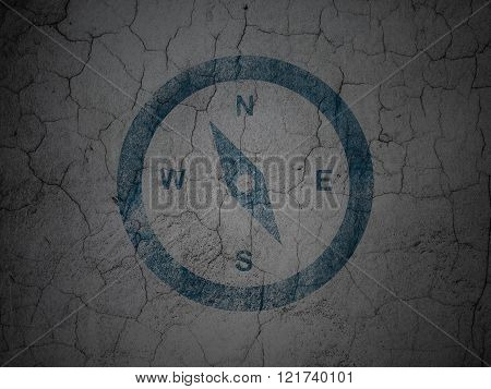 Tourism concept: Compass on grunge wall background