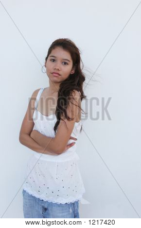 Asian Girl Standing In Front Of A White Wall