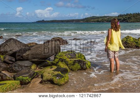 Female admiring the beautiful beaches and coastline of West Maui Kihei Lahaina Kaanapali Green vegetation blue and green waters warm weather magnificent coast