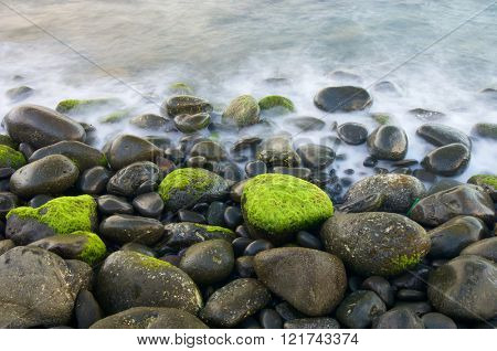 View of a shingle beach in Madeira, Portugal.