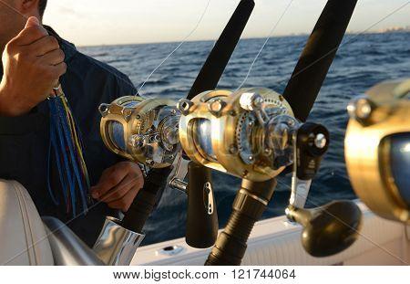 Man holding lure while deep sea saltwater fishing